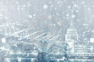 View of St. Paul Cathedral and Millennium Bridge in London with snow
