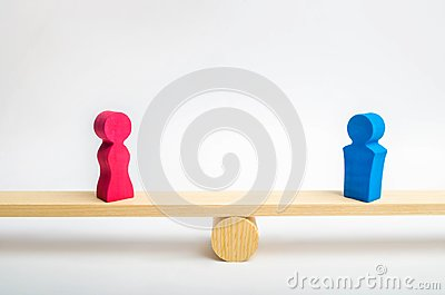 stock image of figures of a man and a woman on the scales. inequality concept : man and women on a weighing balance, gender pay gap. divorce. div