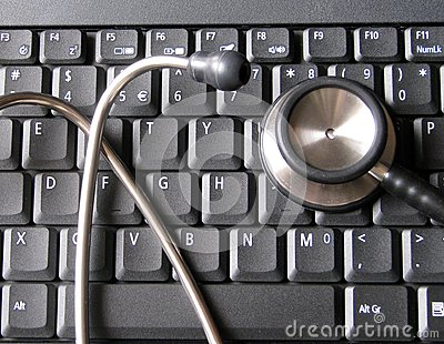 Medical stethoscope on top of laptop computer keyboard. Illustrative of healthcare and technology, informatics, bioinformatics