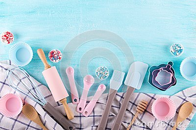Various kitchen baking utensils. Flat lay. Mockup for recipe on blue background.