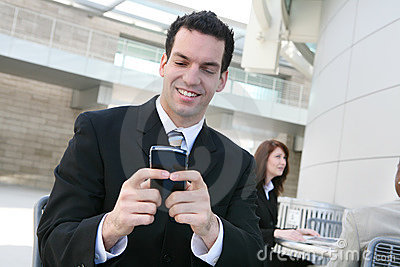 Business Man Texting at Office
