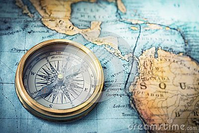 Magnetic compass on world map. Travel, geography, navigation, tou