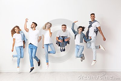 Group of young people in jeans jumping