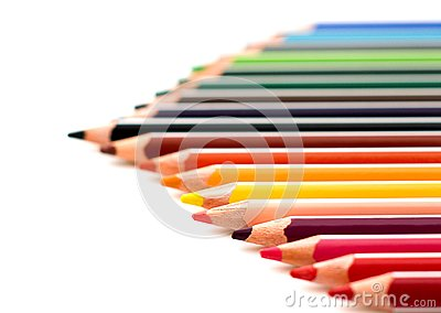 Colored sharpened pencils close up isolated on white background. School drawing set. Multicolor pencils collection. Selective focu