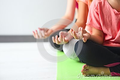 stock image of young woman having fun with kids doing yoga. family sport concep
