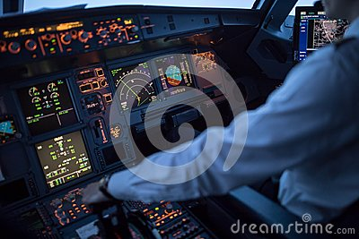Pilot`s hand accelerating on the throttle in a commercial airlineri