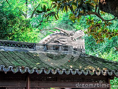 Traditional chinese building with ornate roof and red windows at Yu Gardens, Shanghai, China
