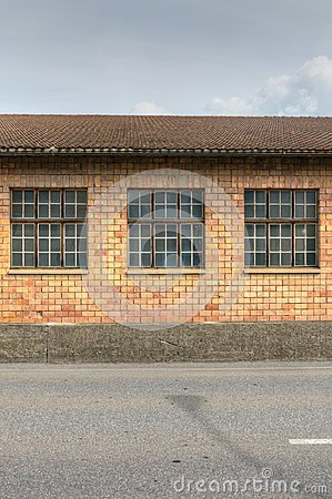 Red brick industrial building with large windows