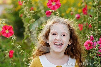 Little girl having happy eyes and showing white teeth.