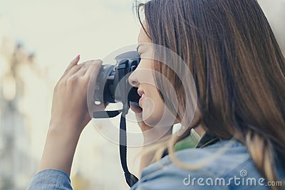 Close up photo of woman taking picture on her digicam for having happy memories of an old city, beauty fashion lifestyle leisure f