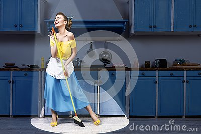Retro pin up woman holding mop singing and cleaning