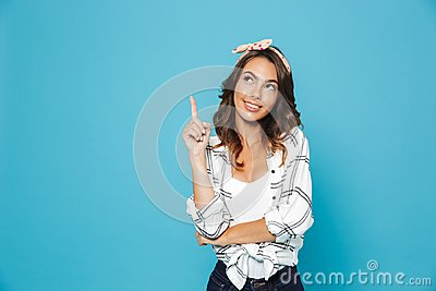 Portrait of lovely excited woman 20s wearing headband smiling an