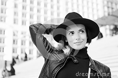Beauty, look, makeup. Woman in black hat smile on stairs in paris, france, fashion. Fashion, accessory, style. Sensual