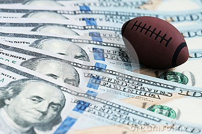 Souvenir ball for playing rugby or American football on US banknotes. The concept of corruption or sports betting.