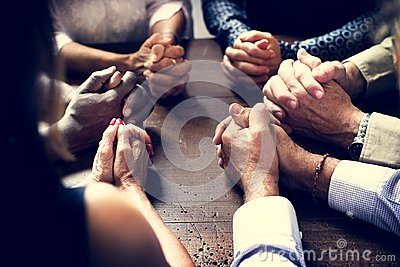 Diverse Group Of Christian People Praying Together