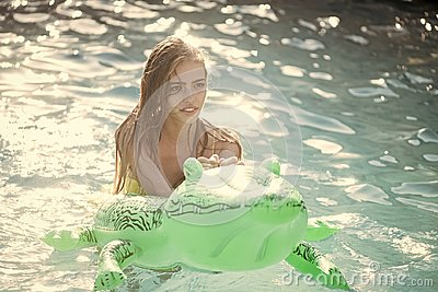 Summer vacation and travel to ocean, maldives. Fashion crocodile leather and girl in water. Adventures of girl on