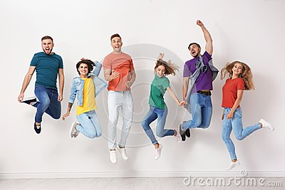 Group of young people in jeans and colorful t-shirts
