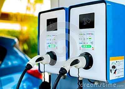 Electric car charging station. Plug for vehicle with electric motor. Coin-operated charging station. Clean energy power.