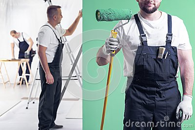 Wall painter in dungarees holding a paint roller on a neo mint g