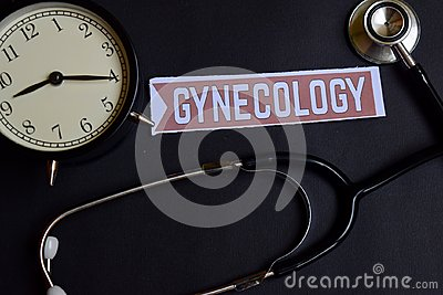Gynecology on the paper with Healthcare Concept Inspiration. alarm clock, Black stethoscope.