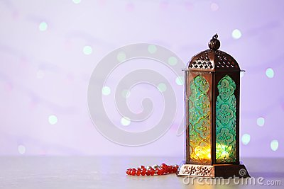 Muslim lamp Fanus with prayer beads and space for design