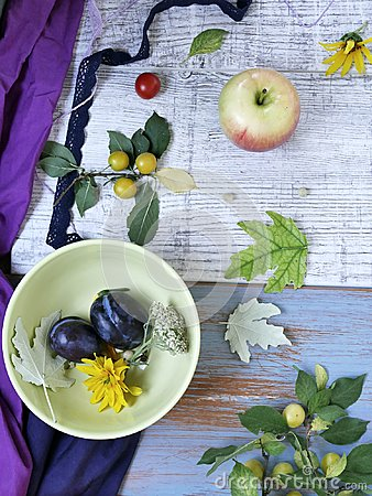 stock image of decorative seasonal composition, on a light wooden background fruits, vegetables, autumn leaves and flowers