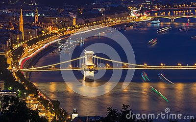 Scenic night view of Chain Bridge and embankment on Danube river in Budapest, Hungary