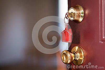 House key in the door opening into apartment