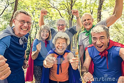 Childlike seniors wearing superhero costumes