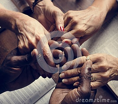 Diverse people holding hands religious concept