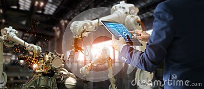 Manager industrial engineer using tablet controlling automation.