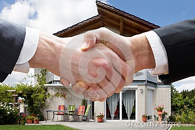 Realtor Shaking Hands With Client After Selling House