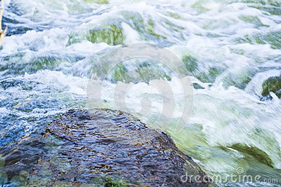 Waterflow. Water flowing over the rock. Mountain river