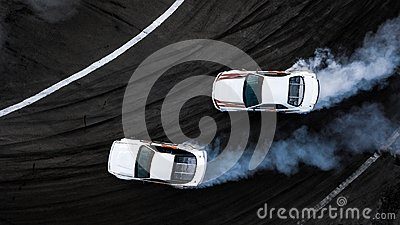 Aerial top view two cars drift battle on race track, Two cars ba