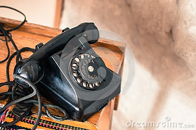 Old fashioned black telephone in retro/vintage style from long gone era