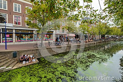 stock image of shopping tourists and students have a sushi lunch at the canal i