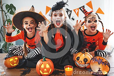 Happy Halloween! a group of children in suits and with pumpkins
