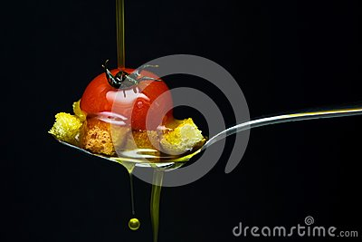 Olive oil over red tomato and bread