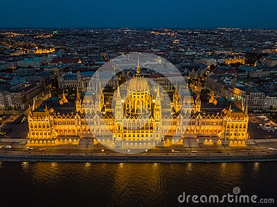 Budapest, Hungary - Aerial view of the beautiful illuminated Parliament of Hungary Orszaghaz at blue hour