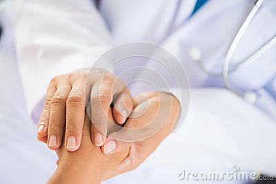 stock image of doctor holding patient`s hand. medicine and health care concept.