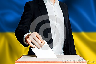 Elections in Ukraine, political struggle. Democracy, freedom and independence concept. Citizen Voter Putting Ballot In to Voting b