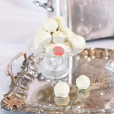 stock image of bunch of white-and-red candies on a glass stand reflecting