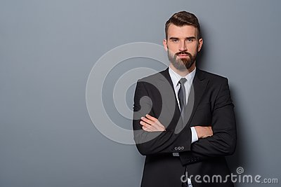 Serious man with crossed arms