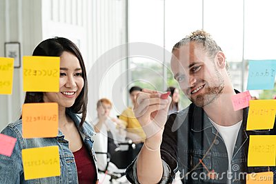 stock image of group of young successful creative multiethnic team smiling and brainstorm together