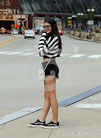 Beautiful argentinian teen walking in the City of Chicago during summer vacations