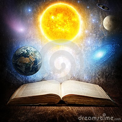 Opened magic book with sun, earth, moon, saturn, stars and galaxy. Concept on the topic of astronomy or fantasy. Elements of this