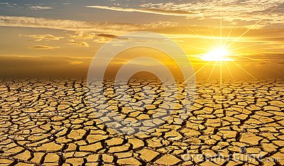 Arid Clay soil Sun desert global worming concept cracked scorched earth soil drought desert landscape dramatic sunset