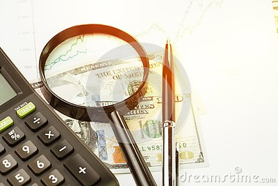 Investment, stock or equity, search for yield concept, magnifying glass, pen and calculator on performance, market price numbers
