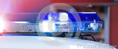 Patrol police car with beautiful emergency sirens lights. Canadian policemen in traffic control activity. A police raid for