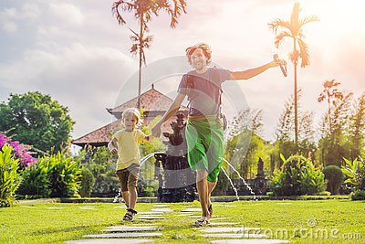 Dad and son tourists in Traditional balinese hindu Temple Taman Ayun in Mengwi. Bali, Indonesia. Traveling with children concept w